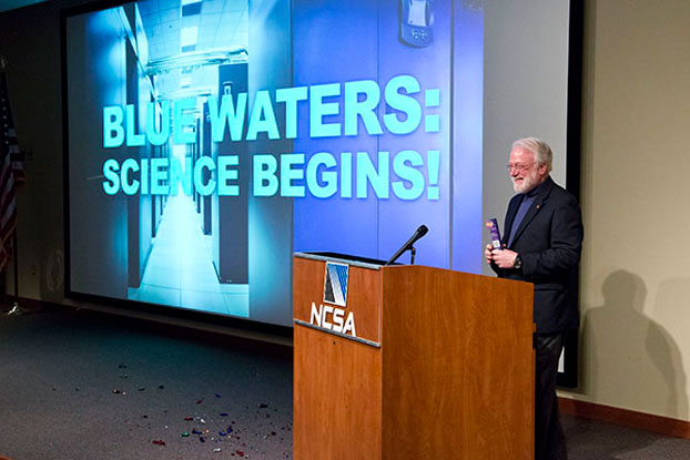 NCSA Director Thom H. Dunning addresses the crowd at the Blue Waters opening celebration held at the NCSA Building.